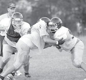 Linemen on the AHS football team go through practice drills, Thursday, Aug. 9.–photo by Mary Huber
