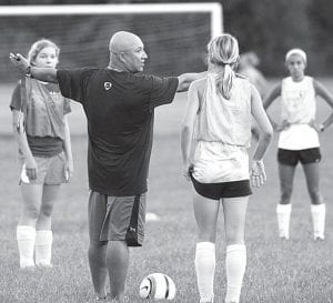 James Kidder, AHS girls soccer coach, gives his team instructions at a Thursday, Aug. 9 practice.– photo by Mary Huber