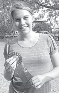 Madison Campbell, 16-yearold daughter of Karl and Jill, Archbold, recently represented Fulton County 4-H with a rifle project at the Ohio State Fair. She was awarded an Outstanding of the Day ribbon, which is reserved for the top 20% of participants. A member of the Hoppin' n' Trottin' 4-H club, she also showed horses. She is a sophomore at Archbold High School.– courtesy photo