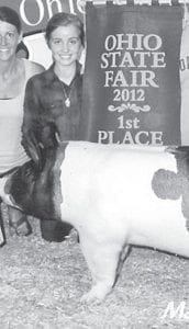 Madison Gigax, 10, daughter of Ryan and Lindsey, Archbold, exhibited the overall Open Show Grand Champion Barrow at the 2012 Ohio State Fair. A fifth grader, she is a member of the Franklin Blue Ribbons 4-H Club.– courtesy photo
