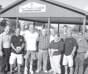 A dedication ceremony was held Tuesday, Aug. 21, for the picnic shelter house that the Archbold Rotary Club built in Woodland Park. The shelter was named in honor of Charles Lugbill, the only remaining charter member of the club. Working with the club were several non-Rotarians. From left: Erich Christman, a non-Rotarian and co-foreman of the construction crew; Orland Santiago, Jim Hogrefe, and Terry Bostelman, spouses of Rotary members who helped, and Bostelman was the other co-foreman; Lugbill; David David, Archbold Rotary Club president; Jennifer Kidder, director, Archbold Parks & Recreation; Keith Radabaugh, president of Archbold Park Board; Jeff Fryman, a former Rotarian who supplied equipment; and Troy Double, Archbold Parks & Recreation parks superintendent.– photo by David Pugh