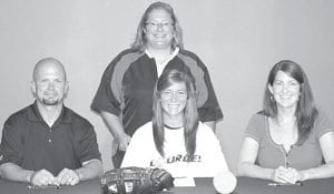 Chelsea Goebel, AHS '12, signs a letter of intent to play softball at Lourdes College, Sylvania. Seated with her are her parents, Jason and Nicole Wendt. Standing is Jo Ann Gordon, Lourdes head coach.– courtesy photo