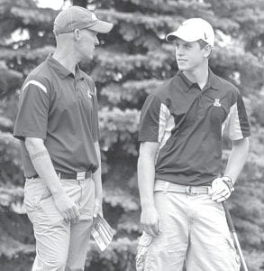 Kevin Boyers, right, gets instructions from Mike Rosebrook, AHS golf coach.– photo by David Pugh
