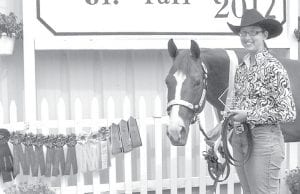 """Melissa Felix and her horse """"Silky Story,"""" with the ribbons they won at the 2012 Henry County Fair.–courtesy photo"""