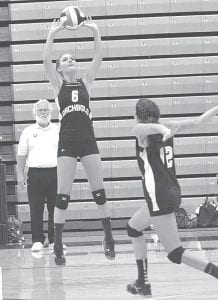 Desi Newman (6) sets the volleyball for a Cayla Walker spike in Archbold's NWOAL victory over Liberty Center, Thursday, Sept. 6. The Streaks are 4-0, 2-0 NWOAL.– photo by Mario Gomez
