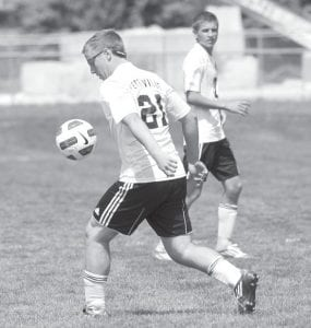 Chris Waidelich gets control of the ball.– photo by Mary Huber