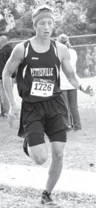PHS junior Jeremy Mann keeps pace in a cross country race.– photo by Mario Gomez