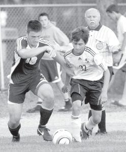 Archbold's Santos Quintanilla (32) races against Maumee's Cody Jozwiak for the ball in the Streaks' 7-0 victory.– photo by Mary Huber (corrected 9/24)