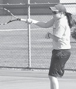 Krista Leupp returns a forehand for AHS.– photo by Mario Gomez