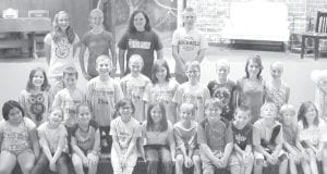 """These boys and girls are the cast members of the Archbold Community Theatre production of """"Porridgegate,"""" a children's theatre show. Teresa Van Sickle, director, said there is a lot of acting talent in the group. Front row, from left: Rebekah Rosales, Meggie Mello, Autumn Pelok, Erin Reichert, Elizabeth Myers, Seth Short, Levi Myers, Sam Myers, Tommy Adkins, Jesse Short, Lydia Whiteman. Second row: Lydia Babcock, Will Nofziger, Spencer Barhite, Autumn Owens, Kate Nofziger, Chris Foor, Anneli Shaw, Amelia Hancock, Leah Pitman. Third row: Alicia Barhite, Jensi Shaw, Sierra Rupp, Caden Garrow. Performances are Sept. 28, 29, Oct. 5, 6, 7.– courtesy photo"""