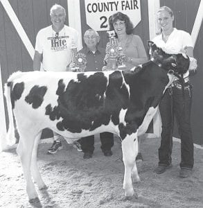 Grand champion dairy feeder calf exhibitor Allison Cuff, right, daughter of Jeff and Dodie, Fayette. Buyers, from left: Cliff Hite, senator; Paul Barnaby, Fulton County commissioner; Sandy Barber, Fulton County recorder; Perry Rupp, Rupp-Rosebrock (not pictured).