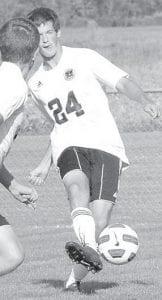 Kurt Siegel passes the ball to a Blackbird teammate.– photo by Mario Gomez