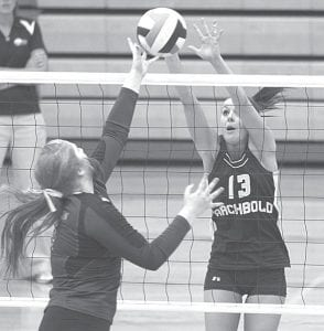 Rachel Brader attempts to block Kidron's Makena Granger in the finals of the Streak Spiketacular.– photo by Mary Huber