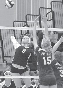 Pettisville's Emily Hubby (3) spikes the ball past a pair of Stryker Panthers, Thursday, Sept. 27.– photo by Mario Gomez