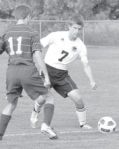 Pettisville's Caleb Liechty looks to a teammate upfield in the Birds' game with Bryan, Sept. 27.– photo by Mario Gomez