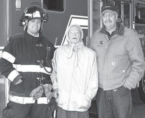 """Three generations of the Meyer family gathered at the Ridgeville Township Fire Department open house, Sunday, Oct. 7. Adam Meyer, left, has been a member of the department for eight years. With him are his grandmother, Doris """"Buzzy"""" Meyer, who just turned 90 years old, and father, Mike Meyer. All are from the Ridgeville area.– photo by Mary Huber"""