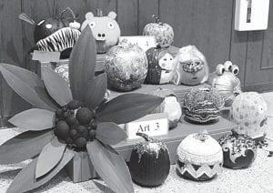 Decorated pumpkins greet visitors to the Pettisville Pumpkin Festival, Sunday, Oct. 7.– photo by Deb Neuenschwander