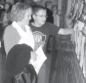 Cathy Avery, Archbold, watches as her grandson, Brooks Behnfeldt, an Archbold fifth grader, shows her a writing project during Grandparents Day, Friday, Oct 5, at Archbold Middle School.– photo by David Pugh