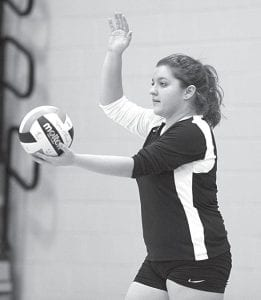 Emily Kauffman winds up to serve.– photo by Mary Huber