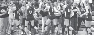Fans congratulate Archbold volleyball players after the Streaks won the NWOAL, Tuesday, Oct. 9.– photo by Mario Gomez