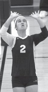 Claire Fry sets the ball to a teammate.– photo by Mary Huber