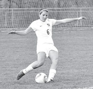 Meggie Yoder, shown in Archbold's sectional final victory over Otsego, scored the Streaks' only goal in their 3-1 district semifinal loss to Swanton, Tuesday, Oct. 23.– photo by Mario Gomez