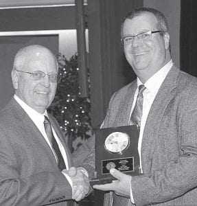 Jerry Rohrs, left, Archbold Citizen of the Year, receives a clock commemorating his award. Presenting it is Norm Beck, vice president of the Archbold Lions Club.– photo courtesy Royal Images