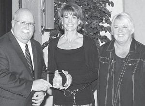 From left, Kevin Sauder, Archbold Area Chamber of Commerce president, presents the Chamber Spirit of Archbold award to Diane Tinsman and Bonnie Rupp, members of the Black Swamp Arts Council. The group promotes the arts and arts activities in Northwest Ohio.– photo courtesy Royal Images