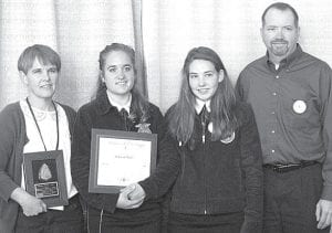 The Meller family at the National FFA Convention. From left: Donna holding her Outstanding Alumni Member plaque; Rebekah holding her American FFA Degree certificate; Hannah, a sophomore at Pettisville; and Gene Meller.– courtesy photo
