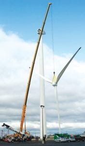 High winds and balky rigging frustrated attempts to attach the rotor (the technical names for the blades attached to the hub) on Friday, Nov. 2. Above, crews attempt to adjust how the rotor hangs in the rigging. Eventually, work was called off on Friday because of high winds. A second attempt the following day was successful.– photo by David Pugh