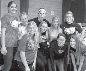 Members of the AHS girls basketball team who helped package relief supplies to the East Coast included, front row at right, Cayla Walker, Winter Fricke. Second row: Alexa Coressel, Brooke Hines, Taylor Coressel, Cassidy Wyse. Back row: Jesse Fidler, Cassi Wyse, Neila Kinsman.– courtesy photo