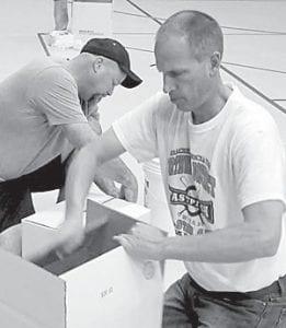 Joe Frank, AHS assistant boys basketball coach, fills a box.– courtesy photo