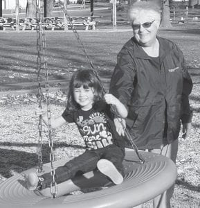 Linda Taquino, Archbold, pushes her great-granddaughter, Cadie Parcher, 3, Defiance, on a swing at Ruihley Park, Sunday afternoon, Nov. 11. Residents enjoyed the 73-degree day by participating in recreational activities outside.– photo by Mary Huber