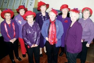 "Members of the Tri-County Red Hats, an informal group of women, visited the Archbold Buckeye office Thursday, Nov. 1. They received a thank you note from Queen Elizabeth II, in response to a card congratulating the queen on her diamond jubilee. Members include, front row from left: Virginia Wiemken, Diane Sessen, Vicky Coombs. Back row: Judy Rand, Jackie Peterson, Sherry Schweinhagen, Karen Keesbery, Marlene Coressel. Schweinhagen, the unofficial leader of the group, is considered their ""Queen Mother.""– photo by David Pugh"