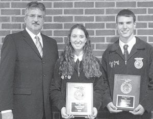 From left: Michael Lane, PHS principal, with Taylor Kruse and Justin Pursel. Lane watched Kruse and Pursel on stage in the National FFA Proficiency Finals competition. Each member was awarded $500 for being a national finalist.– courtesy photo