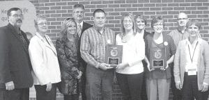 From left: John and Lexie Poulson; Sharlynn and Mike Lane; Jay and Karla Pursel; Kayley Martin, a student teacher at Pettisville High School; Peggy Kruse; Dave Beck; and Donna Meller hold several awards the students collected while at the National FFA Convention. Adults not included in photo: Jeff and Cathy Nofziger, Gene Meller, Curt and Judy Nofziger.– courtesy photo