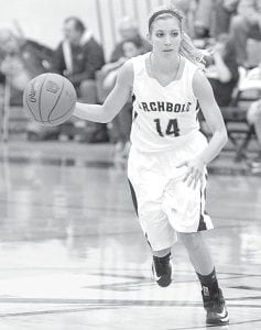 Blue Streak guard Taylor Coressel brings the ball up the court for Archbold.– photo by Mario Gomez