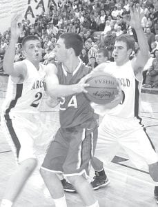 Luke Fisher, left, and Evan Wyse trap Wauseon's Michael Hammons in Archbold's season opener with the Indians, Saturday, Dec. 1, in The Thunderdome. AHS won on a last-second shot by Zeb Frank.– photo by Scott Schultz