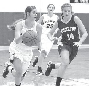 Winter Fricke streaks up the court with Bulldog Laura Schroeder on the chase in Archbold's non-league game with Edgerton, Saturday, Nov. 24. AHS is 3-0 on the young season.– photo by Mario Gomez