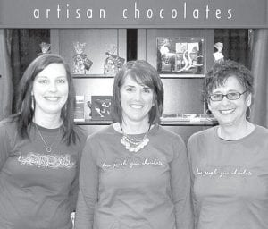 Nancy Bontrager, center, owner and chocolatier of Stella Leona Artisan Chocolates, Pettisville, exhibited at the Chicago Fine Chocolate Show, Nov. 16-18, in Chicago, Ill. With Bontrager are Mattea St. John, left, and Becky Cordes. The Chicago Fine Chocolate Show was a unique fine chocolate and culinary event that featured fine artisanal chocolate creations from around the world.– courtesy photo
