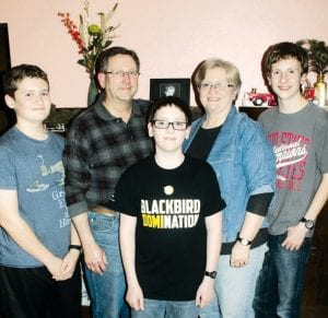 Ryan Rufenacht, center, is 12 years old today, Wednesday, Dec. 12. He was born in the year 2000, making him one of two area youths born on that day. With him, from left, are his brother, John, 13; father, Craig; Ryan; mother, Mary; and brother Evan, 15.– photo by David Pugh
