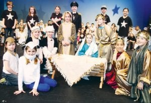 """Archbold second grade students performed their Christmas musical, """"Once Upon A Starry Night,"""" last night, Tuesday. The show tells the story from the viewpoint of the stars. Front row, from left: Jackson Beck, Ella Bowman, Krayton Kern, Isaac Reichert, Ben Dowdy, Kyra Kreiner, Aden McCarty, Devon Morris, Ethan Stuckey. Back row, the students who play the stars: Sydney Hageman, Annika DeLong, Logan Bowerman, Cole Yunker, Brayton Hobbs, Chaney Brodbeck.– photo by David Pugh"""