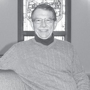 Dale Kern, pastor of St. John Evangelical Lutheran Church relaxes in a pew in the church sanctuary. After ministering to the congregation since 1975, he will retire in June 2013.– photo by David Pugh