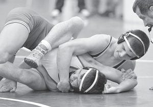 Kenny Price won a 14-2 major decision over Delta's Christian Valentine in Archbold's NWOAL meet at Patrick Henry, Thursday, Dec. 13.– photo by Mario Gomez