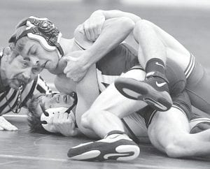 Ben Eggers gets his Delta opponent on his back, Thursday, Dec. 13.– photo by Mario Gomez