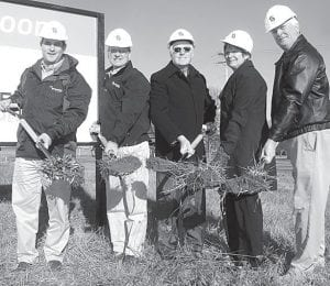 Groundbreaking ceremonies were held Wednesday Dec. 12, for Farm Credit Mid-America, at the future site of its new office at the northwest corner of the intersection of St. Rts. 66 and 34. Participating are, from left: Nick Sheets, FCMA financial services officer; Carl Hess, company vice president; Russ Paxson, Wilson Real Estate; Julie Brink, Archbold Area Chamber of Commerce executive director; and Tom Von Deylen, Henry County commissioner. Construction on the approximately 5,000-square-foot building is set to begin after the first of the year. Completion is anticipated in mid-summer, depending on weather conditions.– photo by David Pugh