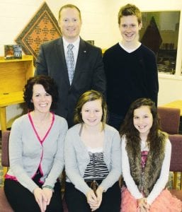 Aaron Rex was selected as the new superintendent at the Archbold school board's Monday, Jan. 7 meeting. He is shown with his family. Seated, from left: his wife, Kami, and daughters Lydia and Ella. Standing with Rex is his son Layne.- photo by David Pugh