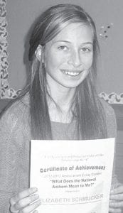 """Elizabeth Schmucker, an Archbold seventh grade student, is one of five area winners of the Defiance Elks Lodge 2012-13 Americanism Essay contest. Schmucker was challenged to write on the theme, """"What does the national anthem mean to me?""""– photo by David Pugh"""