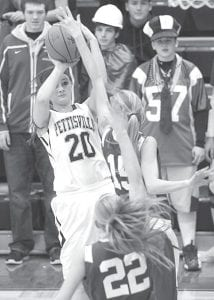 Pettisville's Dana Fricke (20) gets ready to shoot, but Stryker's Christie Huston (15) blocks the shot.– photo by Mary Huber
