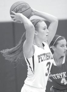 Audra Klopfenstein passes off to a teammate in Pettisville's game with Stryker, Friday, Jan. 11.–photo by Mary Huber